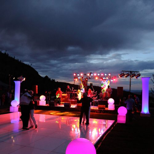 WHITE DANCE FLOOR WITH LIGHTED COLUMNS, GLOBES AND CUBES